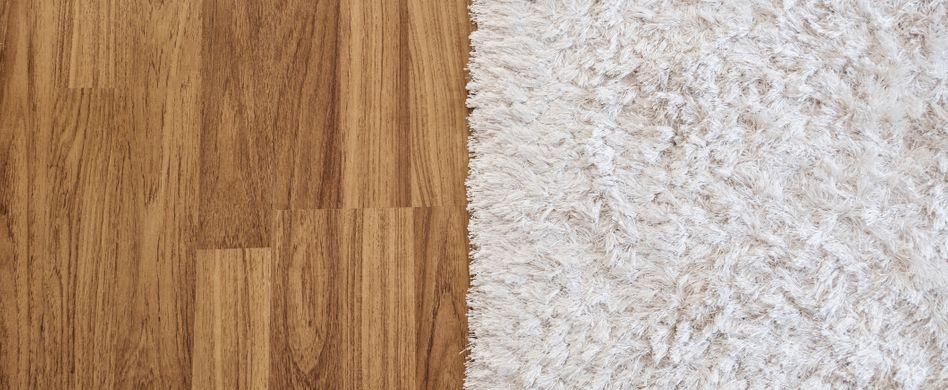 Teppich auf Laminat verlegen: So gehts